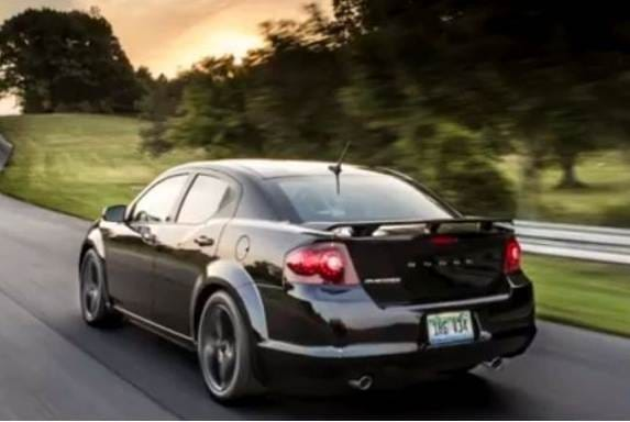 2013-dodge-avenger-blacktop-black-rear-action-600-001
